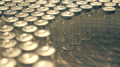 A lot of empty glass vials for medicines are on the assembly line Stock Footage