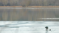 Ice fishing in the winter time Stock Footage