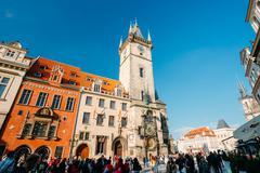 People walking near astronomical clock in Prague, Czech Republic - stock photo