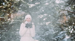 Snow falls on a girl with tree branches Stock Footage