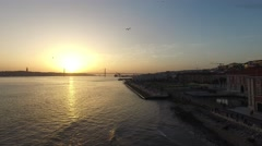 Sunset on the 25 De Abril Bridge in Lisbon, Portugal Stock Footage