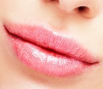Closeup shot of plump female lips Stock Photos