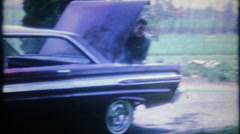 3088 two new 1964  Mercury Comet's in driveway - vintage film home movie Stock Footage