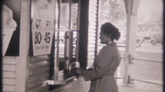 3092 tourist enjoy ice cream from local vendor - vintage film home movie Stock Footage