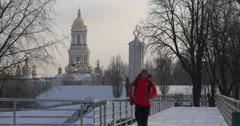 Man is Running by Pedestrian Bridge Man in Red Sporty Jacket is Running Toward Stock Footage