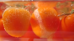 Boiling red tomatoes Stock Footage
