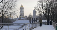 Man is Walking by Bridge Stops And Waiting Winter Park Man in Brown is Trying Stock Footage