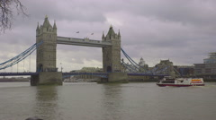 London Bridge and a boat passing through the Thames River Stock Footage