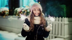 Cheerful woman with bengal lights on Christmas eve, slow motion Stock Footage