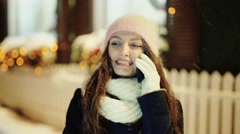 Young woman making a call at Christmas on her mobile phone Arkistovideo