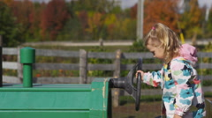 Little girl on a tractor Stock Footage