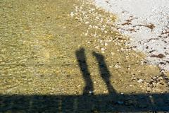 Shadow silhouette of a couple facing each other. Stock Photos
