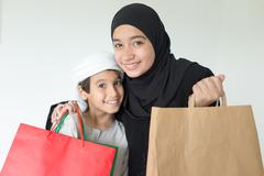 Happy Arabic family having fun time with shopping bags Kuvituskuvat