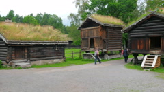 People at norwagian village houses with green grass rooftop, norway, 4k Stock Footage