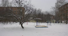 Ravens on a Snow Swings Sandbox Playground Equipment Covered With Snow Childish - stock footage