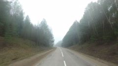 POV, driving on a misty forest road. Arkistovideo