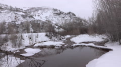 Winter landscape mountain river stream snow 4K Stock Footage
