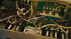 In the metal housing located the board with radio components - stock footage