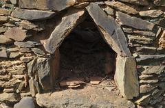 Antique schist stone oven - stock photo