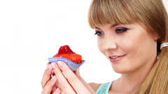Woman holds cupcake sweet food in hand 4K Stock Footage