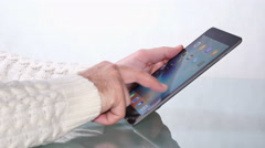 Caucasian Man Surfing the Net with his Tablet - stock footage