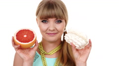 Woman choosing fruit or cake make dietary choice 4K Stock Footage