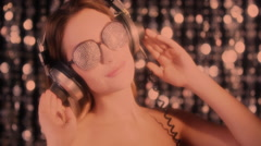 Silver sexy babe headphones diva party disco woman Stock Footage