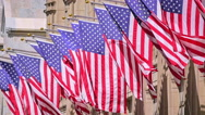 Stock Video Footage of USA United States flags facade waving slow motion sunny day