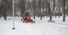 Engine of Red Tractor Covered by Carpet Removes The Snow Bulldozer is Moving Stock Footage