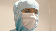 Mannequin in medical protective overalls with a gauze bandage on his face Stock Footage