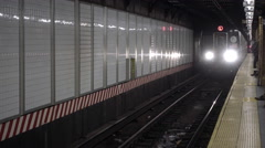 L train pulling into subway station platform at 14th street Union Square stop NY Stock Footage