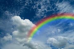 Blue sky with rainbow Kuvituskuvat