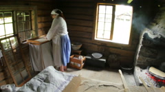 OSLO - NORWAY, AUGUST 2015:, traditionally dressed people making lefse Stock Footage