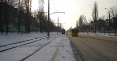 Tram at The Station Cars And Yellow Bus Moving toward Camera Residental Houses Stock Footage