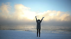 Mountaineer celebrates the conquest of the summit. Concepts: victory, success Stock Footage