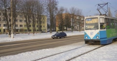 Blue Tram Approaches to a Station Stops Passengers People are Taking a Tram Old Stock Footage