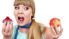 Stock Video Footage of Woman choosing fruit or cake make dietary choice 4K