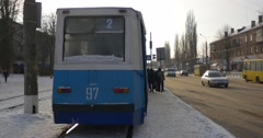 Tram Station at Mir Avenue in Konotop City People Enter And Sits Into Old Wagon Stock Footage