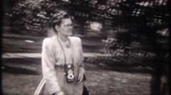 Tourist uses a waist level view finder camera - 3097 vintage film home movie Stock Footage