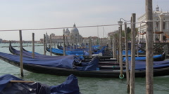 Gondolas moored close to Basilica di Santa Maria della Salute, Venice Stock Footage