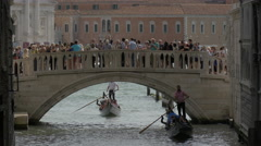Many tourists crossing a bridge in Venice Stock Footage