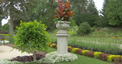 View of a beautiful flower pot, small tree and flower beds at Kitchener, Canada Stock Footage