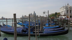 Gondolas moored in Laguna Veneta near Basilica Santa Maria della Salute, Venice Stock Footage