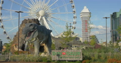View of a Ferris wheel and dinosaurs at Niagara Falls, Canada Stock Footage