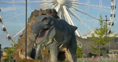 Dinosaurs and volcano at the Dinosaur Adventure Golf at Niagara Falls, Canada Stock Footage
