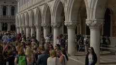 Walking near the beautiful arches and columns of Palazzo Ducale in Venice Stock Footage