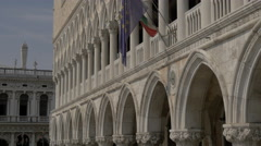 Two flags waving on Palazzo Ducale in Venice Stock Footage