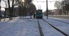 People Are Taking a Tram Wagon is Leaving People Are Walking by a Street Old Stock Footage