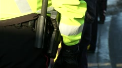 Gun on police officer hip Stock Footage