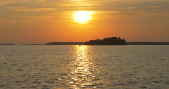 Amazing view of boat navigating on lake at sunset at Killbear Provincial Park - stock footage